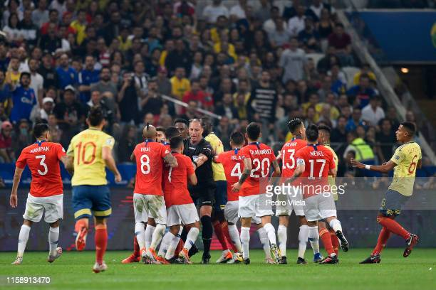 Referee Nestor Pitana argues with Arturo Vidal and Alexis Sanchez of Chile during the Copa America Brazil 2019 quarterfinal match between Colombia...