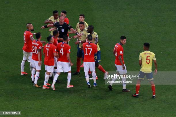 Referee Nestor Pitana argues with players of Chile and Colombia during the Copa America Brazil 2019 quarterfinal match between Colombia and Chile at...