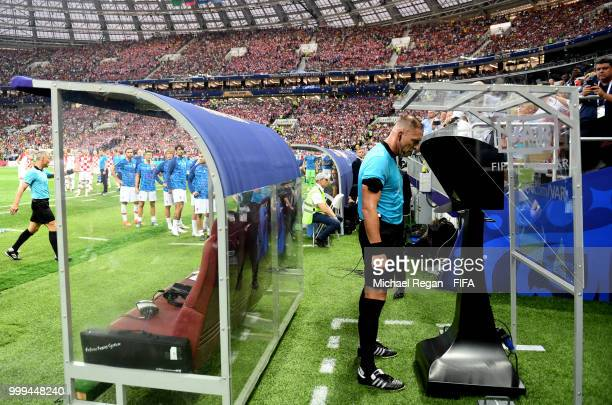 Referee Nestor Pitana consults VAR before awarding a penalty to France during the 2018 FIFA World Cup Final between France and Croatia at Luzhniki...