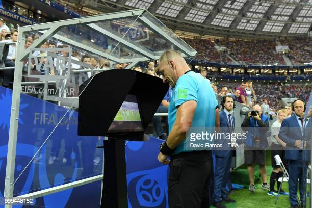 Referee Nestor Pitana consults VAR before awarding France a penalty during the 2018 FIFA World Cup Final between France and Croatia at Luzhniki...