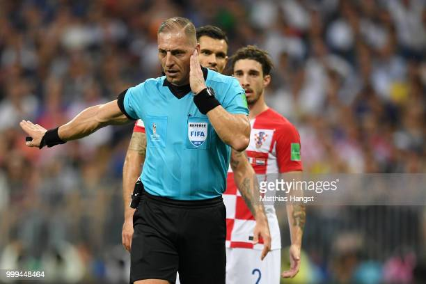 Referee Nestor Pitana holds his hand to his ear before consulting VAR and consequently awarding France a penalty during the 2018 FIFA World Cup Final...