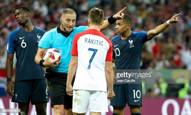Referee Nestor Pitana of Argentina Kylian Mbappe of France during the 2018 FIFA World Cup Russia Final between France and Croatia at Luzhniki Stadium...