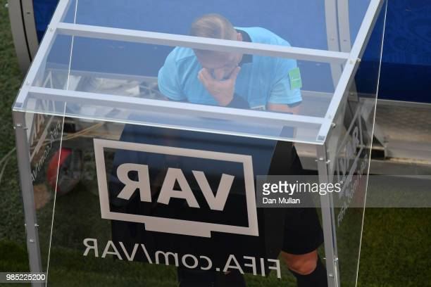 Referee Nestor Pitana reviews the VAR footage during the 2018 FIFA World Cup Russia group F match between Mexico and Sweden at Ekaterinburg Arena on...