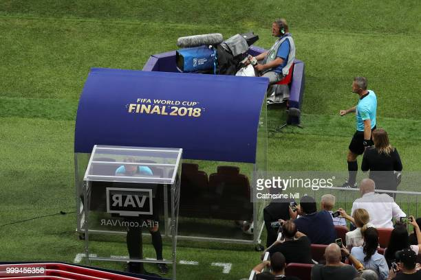 Referee Nestor Pitana reviews VAR footage before awarding France a penalty during the 2018 FIFA World Cup Final between France and Croatia at...