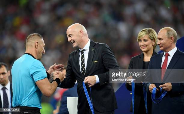 Referee Nestor Pitana shakes hands with Gianni Infantino FIFA President following the 2018 FIFA World Cup Final between France and Croatia at...