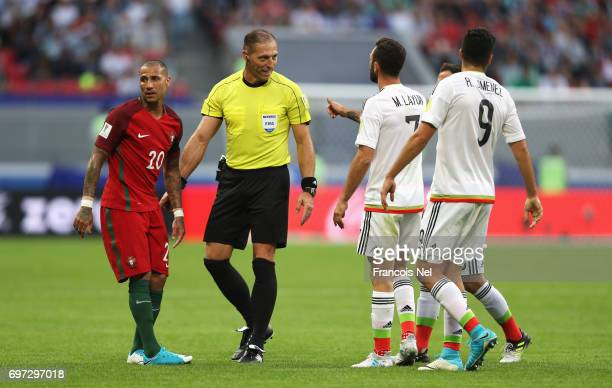 Referee Nestor Pitana speaks to Miguel Layun of Mexico Raul Jimenez of Mexico and Ricardo Quaresma of Portugal during the FIFA Confederations Cup...