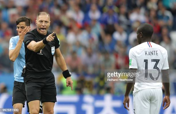 Referee Nestor Pitana talks to Ngolo Kante of France during the 2018 FIFA World Cup Russia Quarter Final match between Uruguay and France at Nizhny...