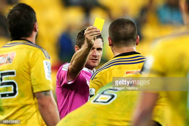 Referee Nick Briant shows Dane Coles of the Hurricanes a yellow card during the round ten Super Rugby match between the Hurricanes and the Blues at...