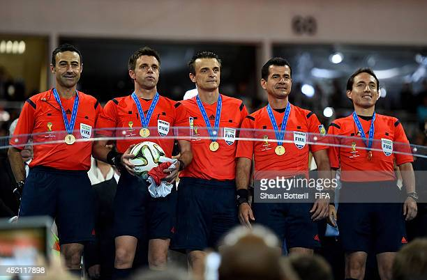 Referee Nicola Rizzoli and match officials pose during the award ceremony after the 2014 FIFA World Cup Brazil Final match between Germany and...