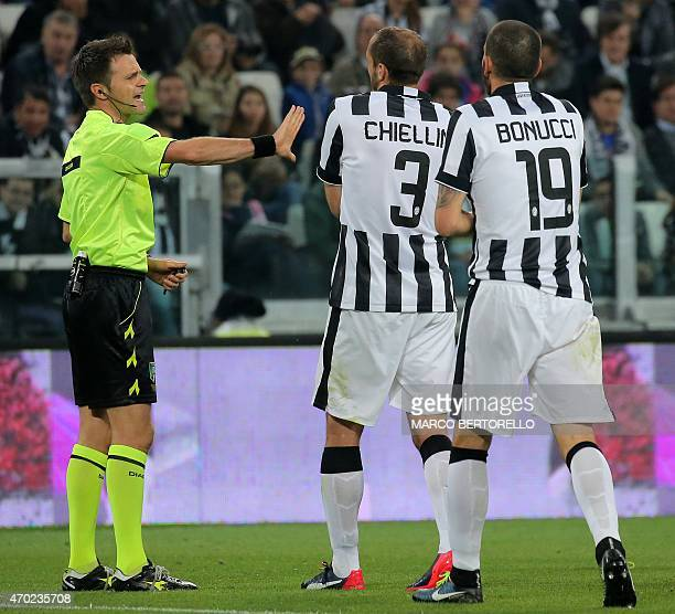Referee Nicola Rizzoli argues with Juventus' defender Giorgio Chiellini and Lazio's Bosnian midfielder Senad Lulic the Italian Serie A football match...