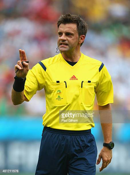 Referee Nicola Rizzoli gestures during the 2014 FIFA World Cup Brazil Group F match between Nigeria and Argentina at Estadio BeiraRio on June 25 2014...