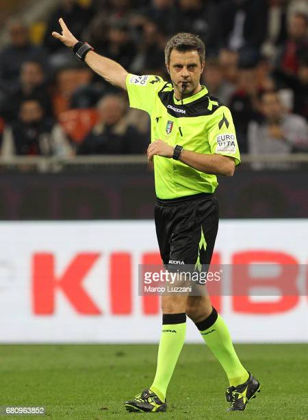 Referee Nicola Rizzoli gestures during the Serie A match between AC Milan and AS Roma at Stadio Giuseppe Meazza on May 7 2017 in Milan Italy