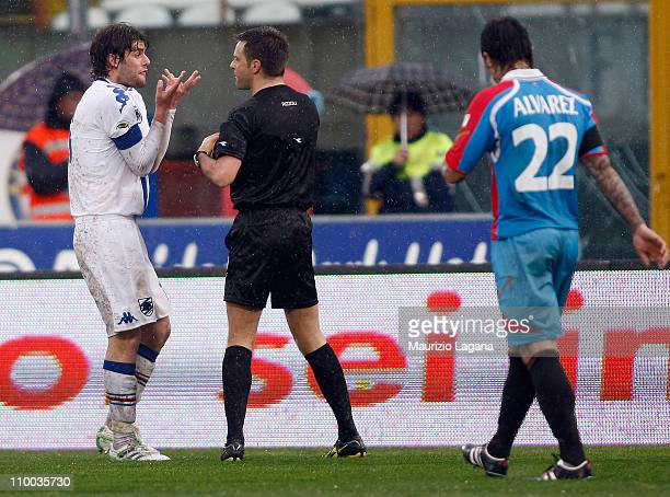 Referee Nicola Rizzoli gets a red card to Andrea Poli of Sampdoria during the Serie A match between Catania Calcio and UC Sampdoria at Stadio Angelo...