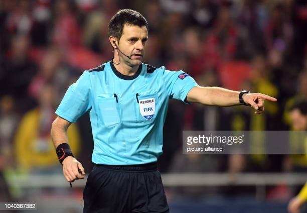Referee Nicola Rizzoli in action during the first leg of the Champions League quarter final knockout match between the Portuguese champions Benifica...
