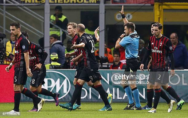 Referee Nicola Rizzoli invalidates a goal during the Italian Serie A football match AC Milan versus Juventus on October 22 2016 at the San Siro...