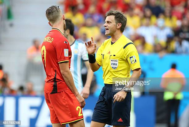 Referee Nicola Rizzoli of Italy explains his decision during the 2014 FIFA World Cup Brazil Quarter Final match between Argentina and Belgium at...