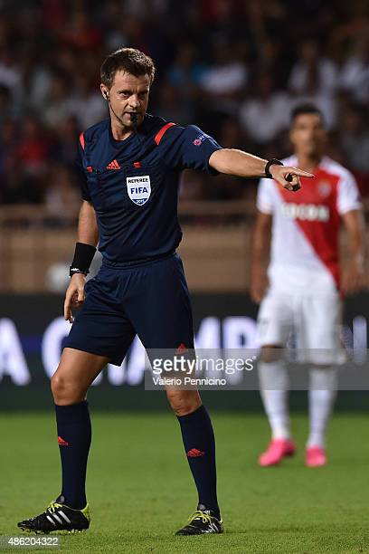 Referee Nicola Rizzoli signals a foul during the UEFA Champions League qualifying round play off second leg match between Monaco and Valencia on...