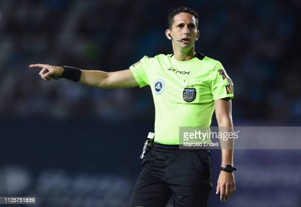 Referee Nicolas Lamolina gestures during a match between Racing Club and Godoy Cruz at Juan Domingo Peron Stadium on February 18 2019 in Avellaneda...