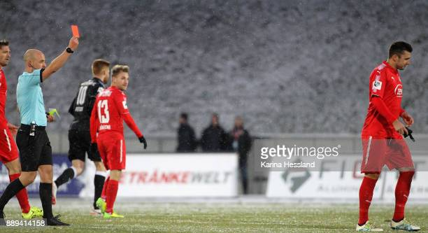 Referee Nicolas Winter shows the yellowred card to Davy Frick of Zwickau during the 3Liga match between FSv Zwickau and Hallescher FC at Stadion...