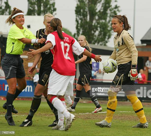 Referee Nicole Petignat jumps in to brake up a argument between Johanna Frisk of Umea IK and Alex Scott of Arsenal during the Womens UEFA Cup Final...