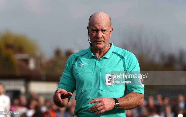 Referee Nigel Miller in action during the Sky Bet League One match between AFC Wimbledon and Northampton Town at The Cherry Red Records Stadium on...