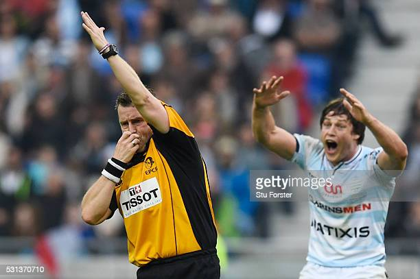 Referee Nigel Owens blows a whistle to give Saracens a penalty during the European Rugby Champions Cup Final match between Racing 92 and Saracens at...