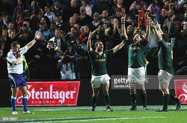 Referee Nigel Owens blows the final whistle as Heinrich Brussow Pierre Spies and John Smit of South Africa celebrate their win during the Tri Nations...