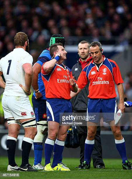 Referee Nigel Owens of Wales confirms France's second try with the TMO during the RBS Six Nations match between England and France at Twickenham...