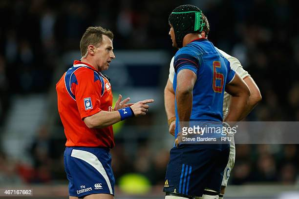 Referee Nigel Owens of Wales speaks to Chris Robshaw of England and Thierry Dusautoir of France during the RBS Six Nations match between England and...