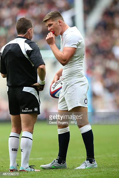 Referee Nigel Owens of Wales speaks with Owen Farrell of England during the QBE International match between England and Ireland at Twickenham Stadium...