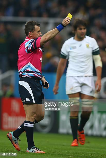 Referee Nigel Owens showing a yellow card to Greig Laidlaw of Scotland during the Rugby World Cup 2015 Pool B match between South Africa and Scotland...