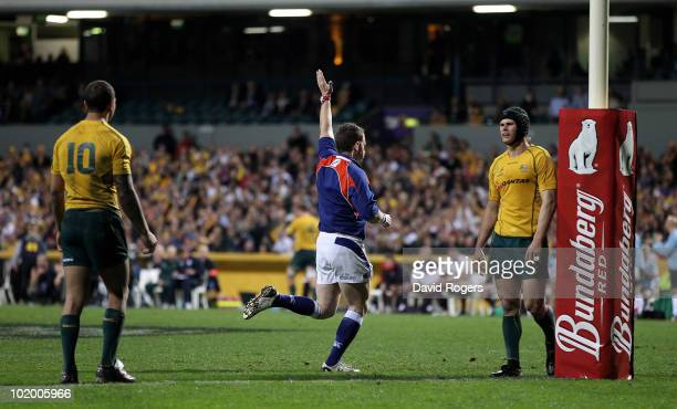 Referee Nigel Owens signals a second try to England after the England pack overpower the Australian Wallabies on the try line during the Cook Cup...