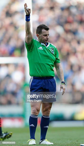 Referee Nigel Owens signals for a penalty during the Heineken Cup SemiFinal match between Saracens and ASM Clermont Auvergne at Twickenham Stadium on...