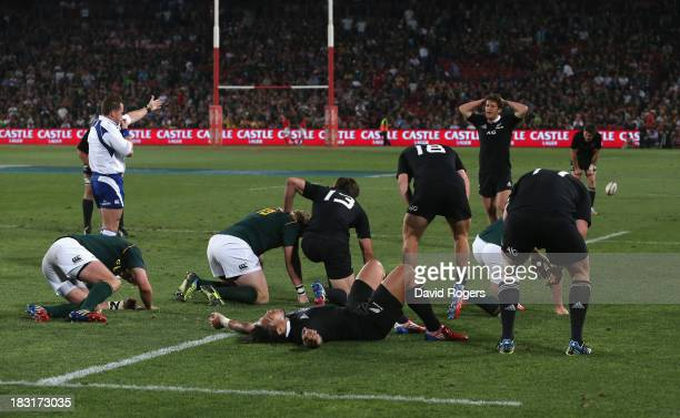 Referee Nigel Owens, signals for the end of the match as both teams are exhausted at the final whistle during the Rugby Championship match between...