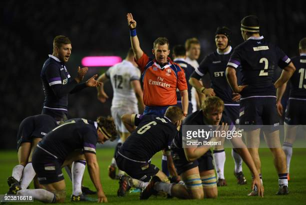 Referee Nigel Owens signals turnover ball for Scotland during the NatWest Six Nations match between Scotland and England at Murrayfield on February...