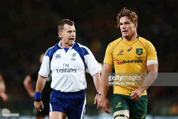 Referee Nigel Owens talks to Michael Hooper of the Wallabies during The Rugby Championship Bledisloe Cup match between the New Zealand All Blacks and...