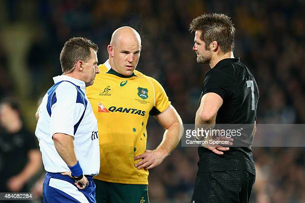 Referee Nigel Owens talks to Wallabies captain Stephen Moore and All Blacks captain Richie McCaw during The Rugby Championship Bledisloe Cup match...