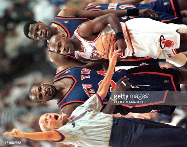 Referee Nolan Fine ejects New York Knicks forward Charles Oakley for fighting as Miami Heat guard Tim Hardaway and Knicks center Patrick Ewing watch...