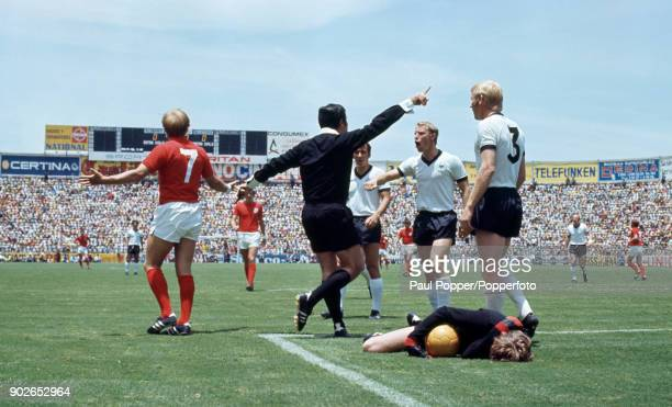 Referee Norberto Angel Coerezza of Argentina is confronted by German defender Berti Vogts after England's Francis Lee had clashed with Sepp Maier...