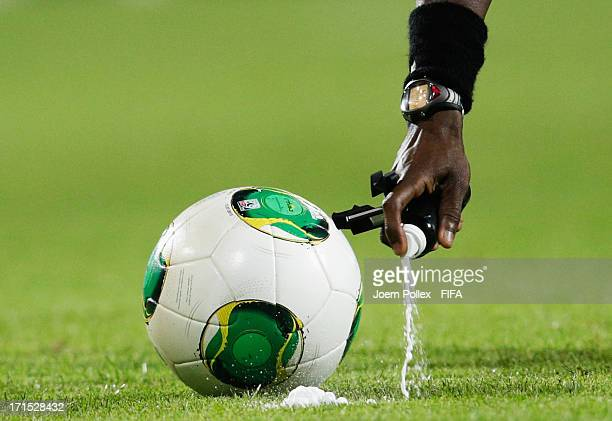 Referee Noumandiez Doue marks a line in front of the ball with vanishing spray to mark out a free kick during during the FIFA U-20 World Cup Group C...