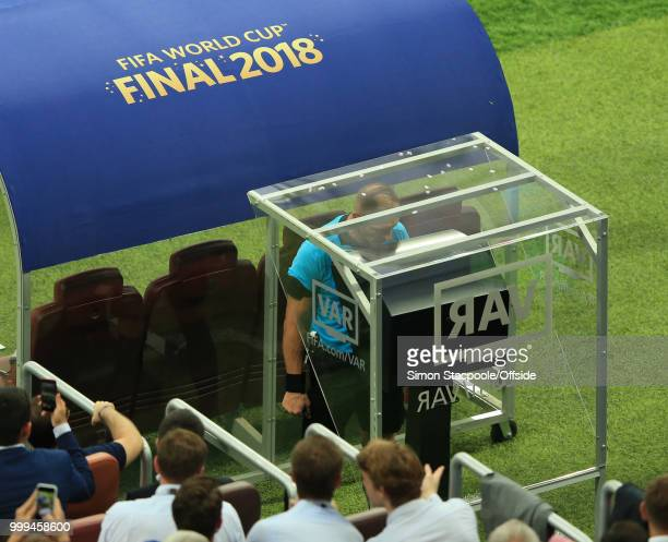 Referee Néstor Pitana consults VAR before awarding a penalty kick to France during the 2018 FIFA World Cup Russia Final between France and Croatia at...