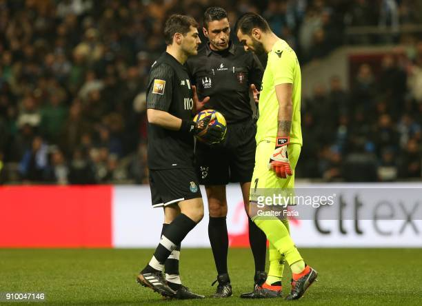 Referee Nuno Almeida with FC Porto goalkeeper Iker Casillas from Spain and Sporting CP goalkeeper Rui Patricio from Portugal before the penalty...