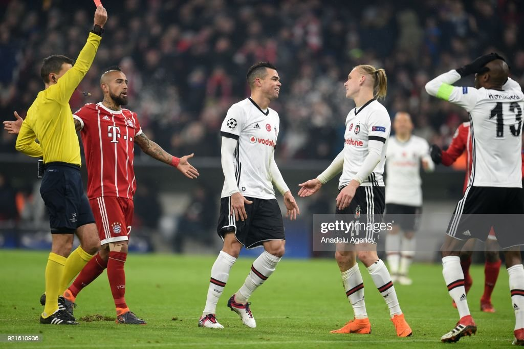 Referee Octavian Sovre (L) shows Domagoj Vida of Besiktas the red card during the UEFA Champions League Round of 16 soccer match between FC Bayern Munich and Besiktas at the Allianz Arena in Munich, Germany, on February 20, 2018.