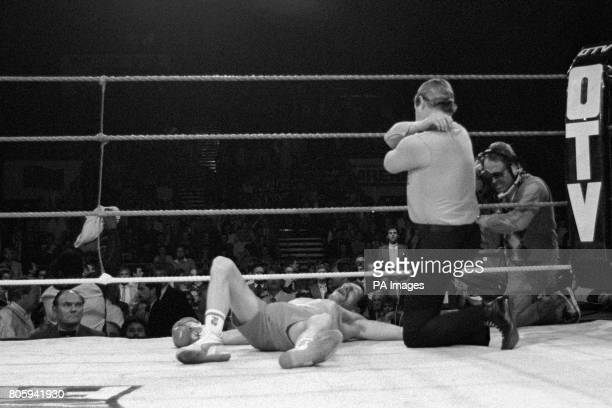 Referee Octavio Meyran counts out Pat Cowdell as Azumah Nelson successfully defended his WBC featherweight title in the first round