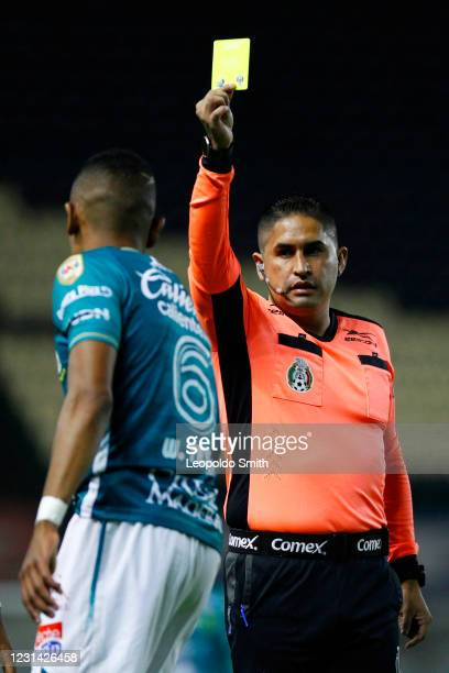 Referee of the match Oscar Mejia, shows a yellow card to William Tesillo of Leon during the 8th round match between Leon and Cruz Azul as part of the...