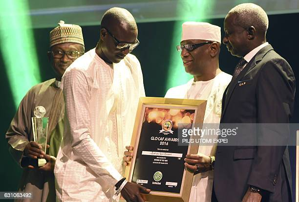 Referee of the Year Gambian Bakary Gassama receives his award during the African Footballer of the Year Awards in Abuja on January 5 2017 Algerian...