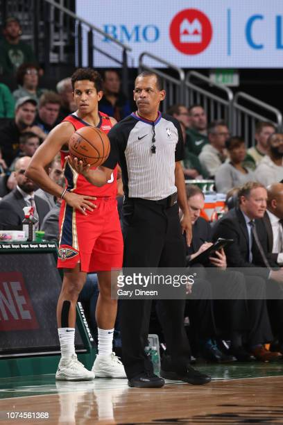 Referee offcial Eric Lewis holds the ball during the game between the New Orleans Pelicans and Milwaukee Bucks on December 19 2018 at the Fiserv...