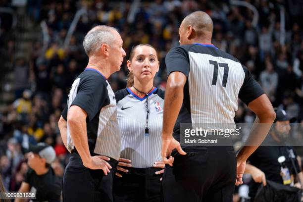Referee official Ashley MoyerGleich huddles with Karl Lane and Jason Phillips during the game between the Los Angeles Lakers and San Antonio Spurs on...