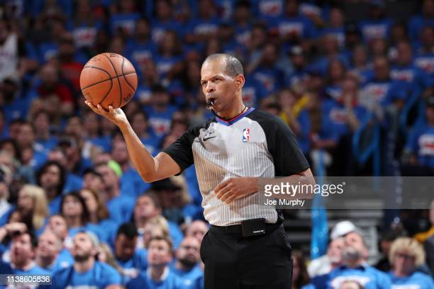 Referee official Eric Lewis handles the ball during Game Four of Round One of the 2019 NBA Playoffs on April 21 2019 at Chesapeake Energy Arena in...