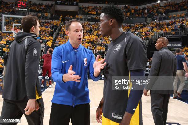 Referee official Josh Tiven speaks with Victor Oladipo of the Indiana Pacers before the game against the Cleveland Cavaliers in Game Three of Round...